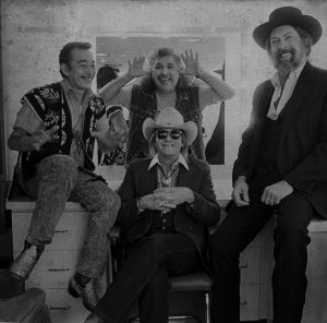 Doug Sahm (seated) with the Texas Tornados (from left, Flaco Jimenez, Freddy Fender, and Augie Meyers).