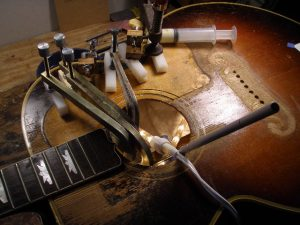 Don't Think Twice, It's Alright: A rare '53 Gibson J-200 under goes intensive care on Ed Reyonld's work bench. (Courtesy Ed Reynolds)