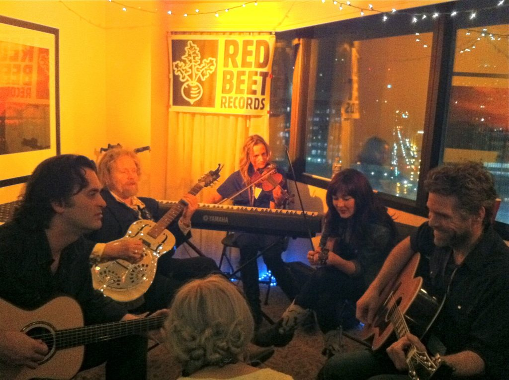 Rod Picott and Amanda Shires (at right) swap songs with Peter Cooper and Tom Mason (at left) and other friends in the Red Beet Records room. (Photo by Richard Skanse)
