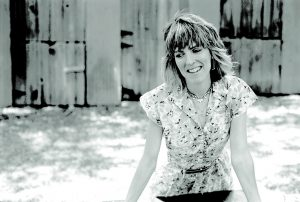 Lucinda Williams, portrait at Paramount Ranch, Agora Hills, California. 15 June 1988. (Photo by Greg Allen)