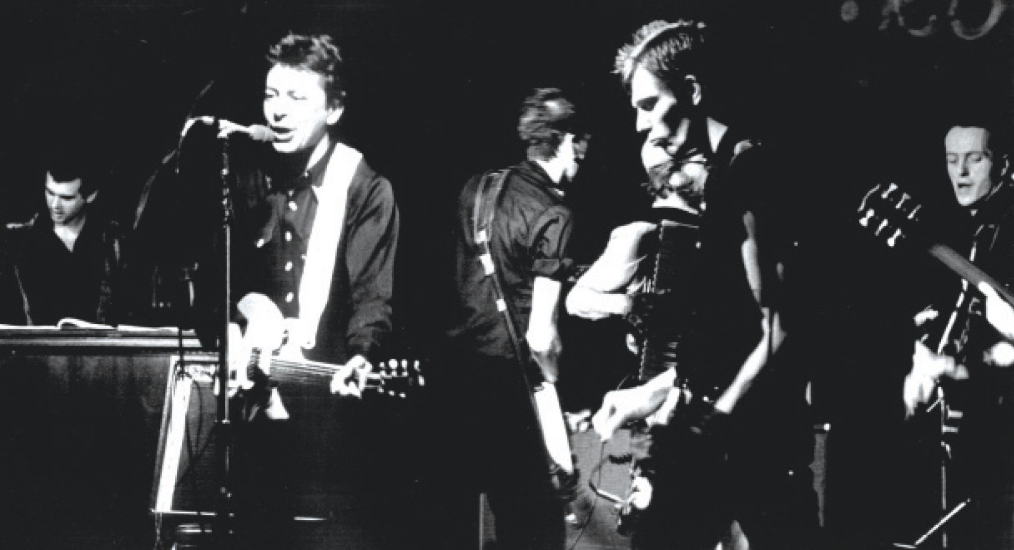 Joe Ely onstage with the Clash in Lubbock in 1979. (Photo by Milton Adams)