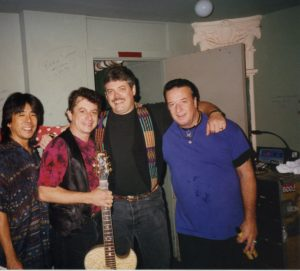 Brothers of the road: (from left) Glenn Fukunaga, Joe Ely, Lloyd Maines and Jesse Taylor in 1996. (Photo courtesy Lloyd Maines)