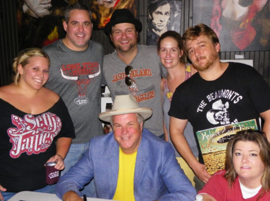 Robert Earl Keen (center) with members of the LSM gang (from left, Kristen Townsend, Shane Jones, Zach Jennings, Megan Jennings, Richard Skanse and Melissa Webb) at his Aug. 30 in-store at Lone Star Music in Gruene. (Photo by Tiffany Burgess)