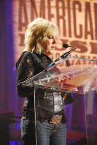 Lucinda Williams accepting her lifetime achievement award for songwriting. (Photo by Lynne Margolis)
