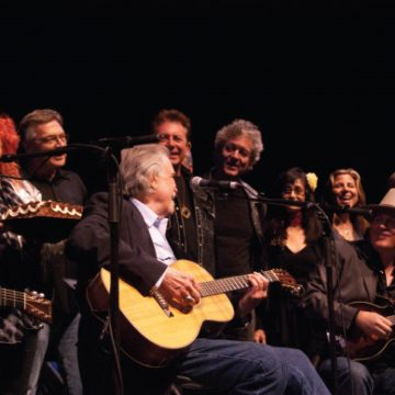 Everybody loves that Guy: (from left) Lyle Lovett, Jessie Scott of MusicFog.com, Terry Allen, Clark, Joe Ely, Rodney Crowell, Rosie Flores, Terri Hendrix, Shawn Camp, and Liz Foster and Kelley Mickwee of the Trishas (Photo by Lynne Margolis)