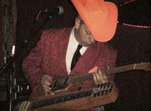 Junior Brown and his signature Guit-Steel. (Photo by D.C. Bloom)