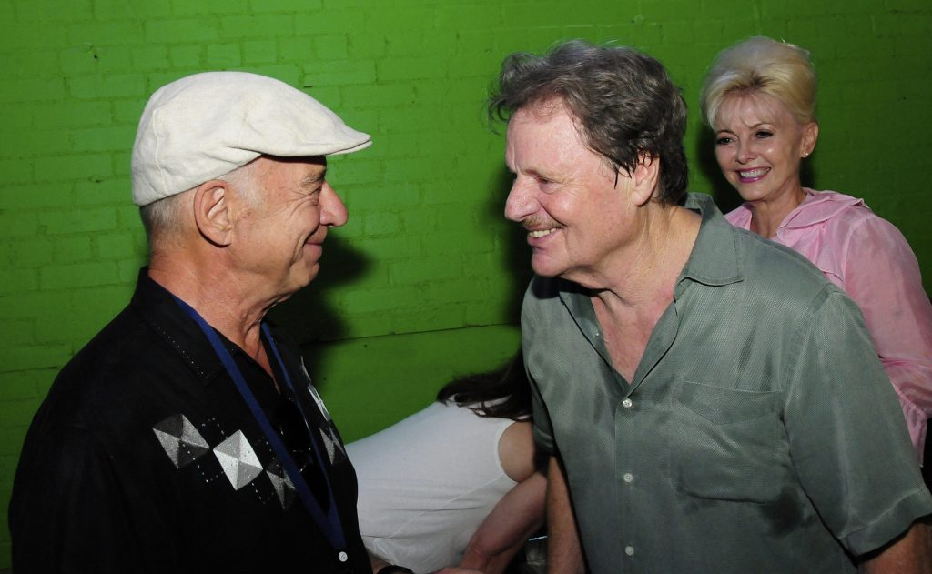 Man of the hour Lucky Tomblin with Terri Hendrix (onstage, above) and with Delbert McClinton backstage at the Texas Music Theater. (Photos by Diana Finlay Hendricks)