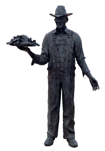 "C.B. ""Stubb"" Stubblefield Memorial (Bar-B-Que Beyond the Grave), 1999. Mixed media with bronze and brick. Lubbock Arts Allinance, Lubbock, TX. (Taken from the book Terry Allen, Courtesy of University of Texas Press.)"