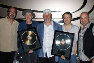 LSM Hall of Fame Inductee Robert Earl Keen (center) with his Best Live Act-winning band (Marty Muse, Bill Whitbeck, Rich Brotherton and Tom Van Schaik) (Photo by Lynne Margolis)