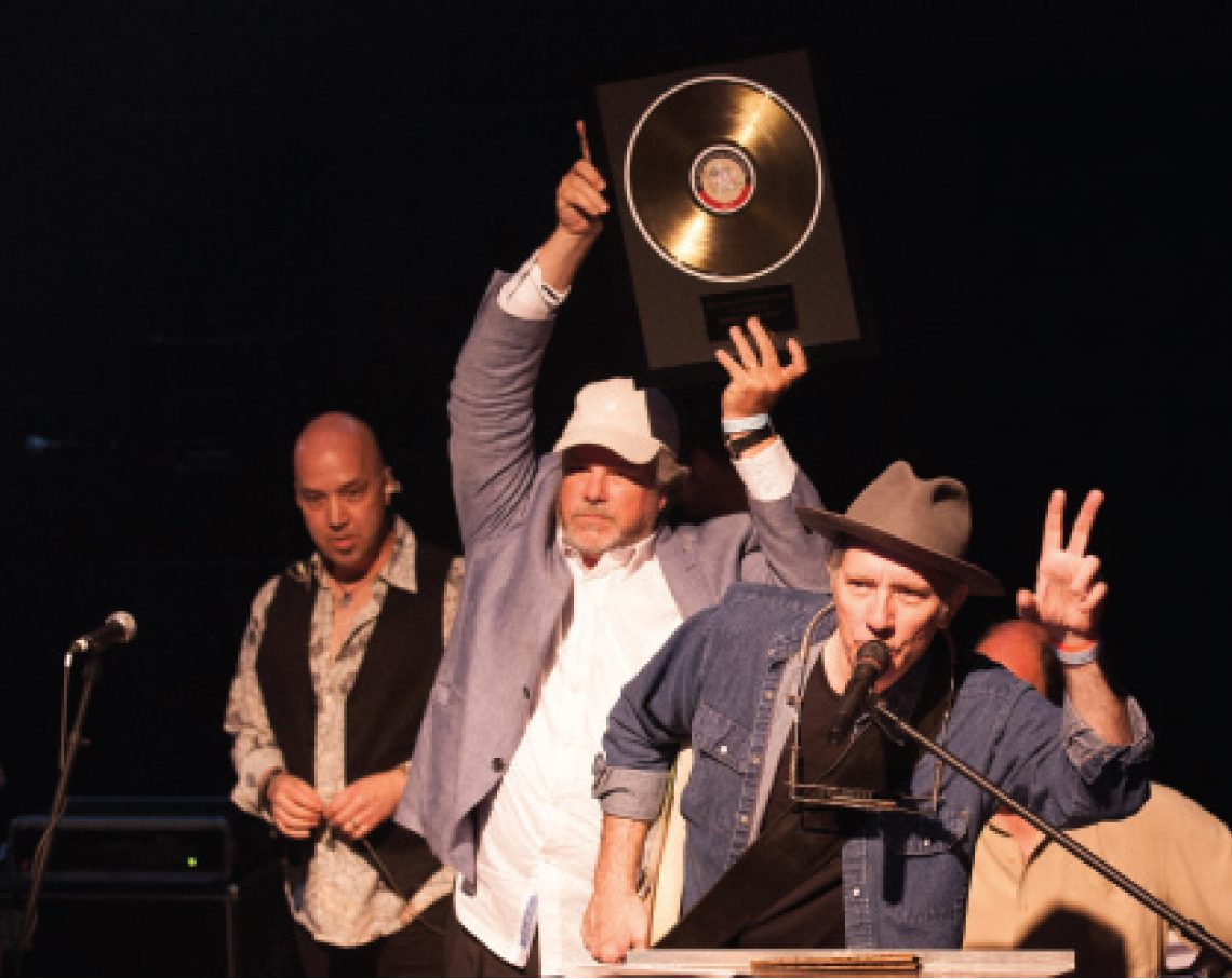 "Robert Earl Keen and band accepting their ""Best Live Act"" award. (Photo by Sandra Eidenberg)"