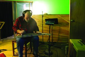 "Jon Dee Graham recording ""Strange Conversation"" at Wire Recording in Austin. (Photo by Brian T. Atkinson)"