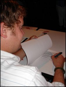 Randy Rogers singing his record contract at Cheatham Street Warehouse on July 30, 2005. (Photo by HalleyAnna Finlay)