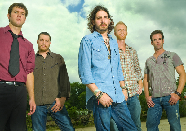 "Mark ""Gus"" McCoy (in red shirt) with Micky and the Motorcars (Courtesy Micky and the Motorcars)"
