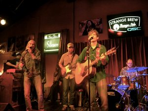 Colin Gilmore (with his dad, Jimmie Dale Gilmore, at left) playing his album-release show at Strange Brew Lounge Side in August. (Photo by Tiffany Walker)