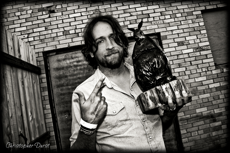Songwriter of the Year Hayes Carll with his LSM Award (a Doug Moreland-chainsaw carved LSM Dillo!) (Photo by Christopher Durst)