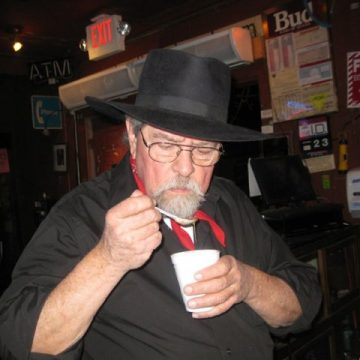 Kent Finlay taste-testing his black-eyed peas. (Photo by Jenni Finlay)