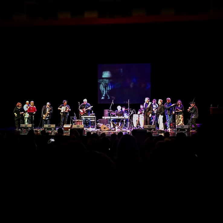 """Terry Allen and the Panhandle Mystery Band (and a few very special guests) performing """"Lubbock (on Everything)"""" at Texas Tech University's Allen Theatre. (Photo by Thomas Mooney)"""
