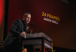 "Jason Isbell accepting one of his two Grammys (this one for Best American Roots Song, for ""24 Frames""). (From Grammy.com)"