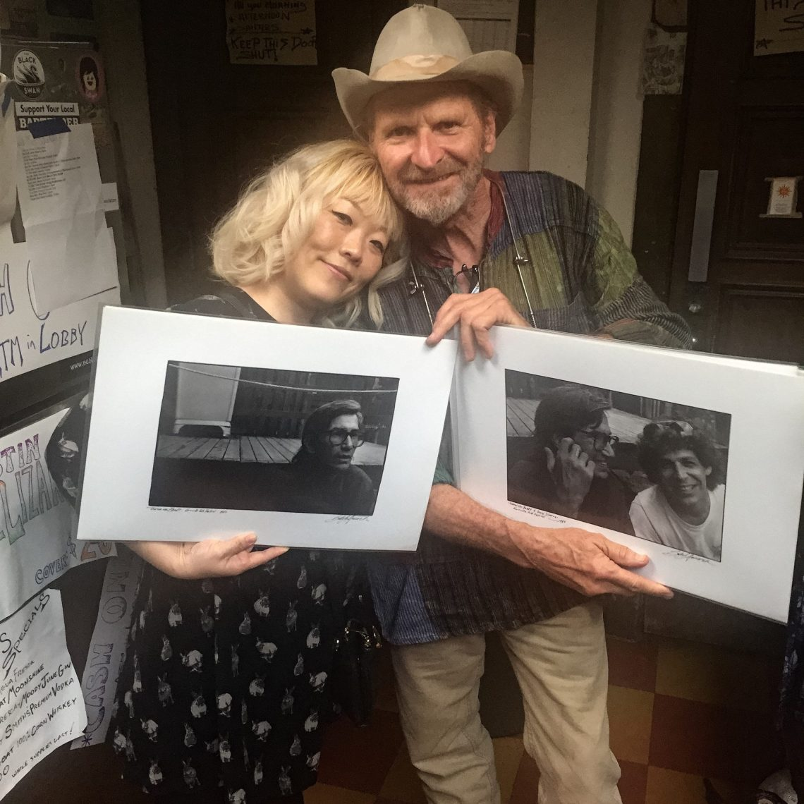 BettySoo and Butch Hancock at the Cactus Cafe, holding photos Hancock took of Townes Van Zandt at the Kerrville Folk Festival. (Photo by Tiffany Walker)