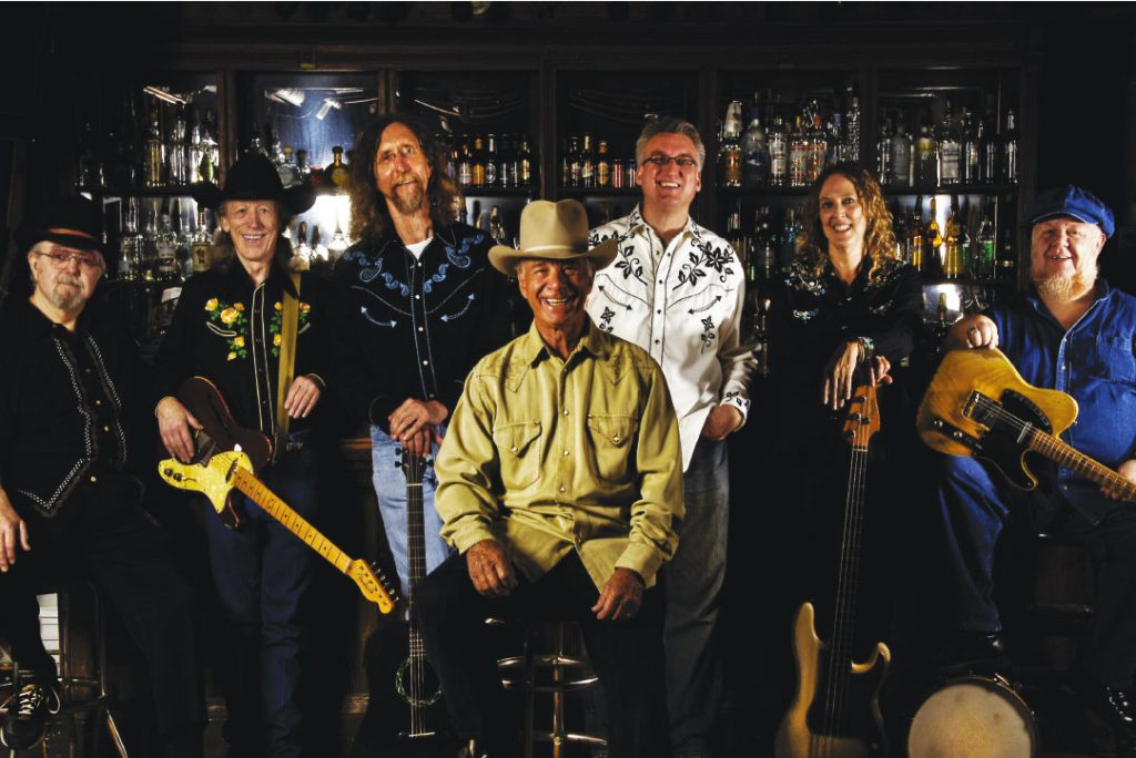 Lucky Tomblin (center) with his all-star Lucky Tomblin Band (from left, Earl Poole Ball, John X Reed, Bobby Arnold, Jon Hawn, Sarah Brown, and Redd Volkaert. (Photo by Rodney Bursiel)