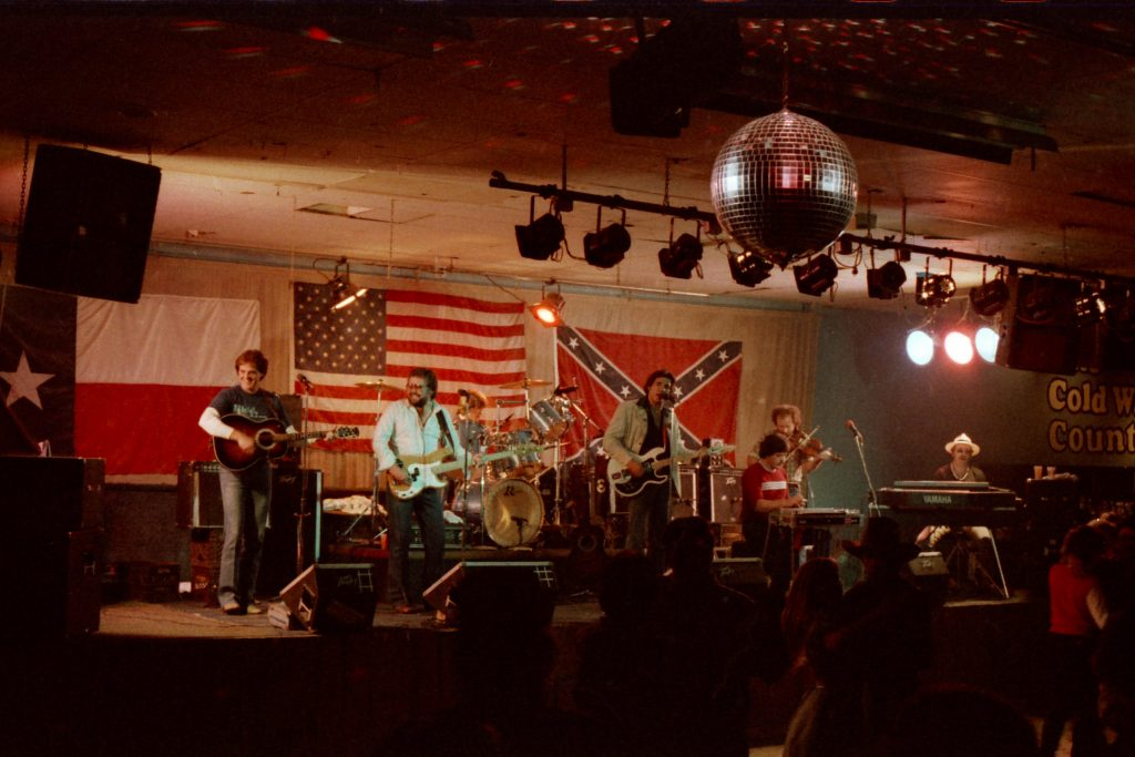 The Maines Brothers Band at Cold Water Country in 1986: (Left to right) Steve Maines, Jerry Brownlow, Donnie Maines, Kenny Maines, Lloyd Maines, Richard Bowden, and Cary Banks (Photo by T.G. Caraway)
