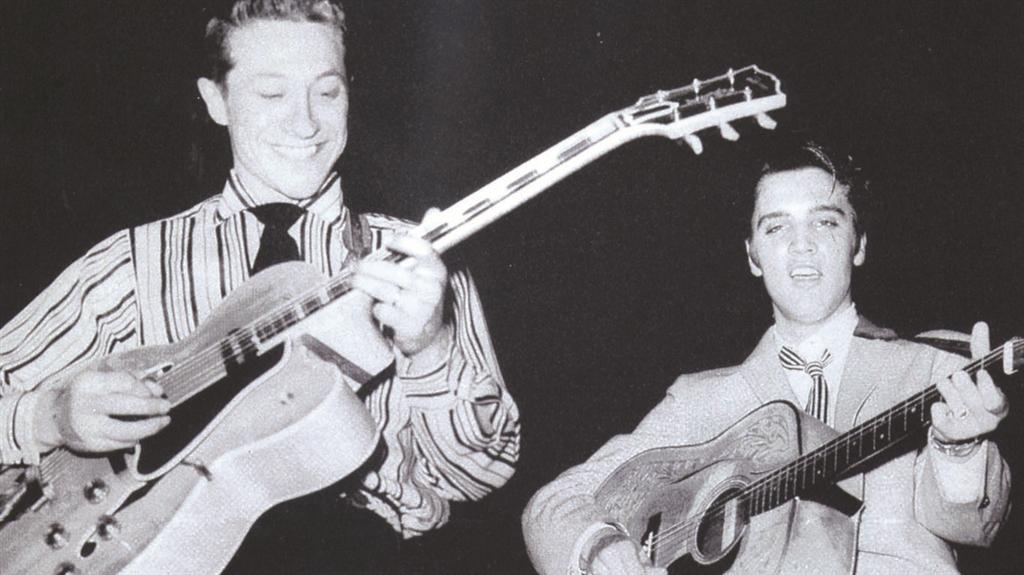 Scotty Moore and Elvis Presley