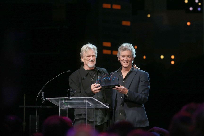 Rodney Crowell inducting Kris Kristofferson into the Austin City Limits Hall of Fame. (Photo by Gary Miller, Courtesy KLRU-TV/Austin City Limits)
