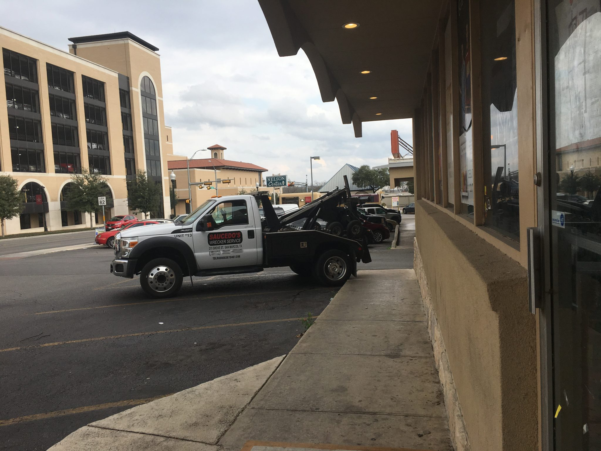 Tow truck in front of Superfly's Lone Star Music Emporium at the Nelson Center in San Marcos, Texas. (Photo by Richard Skanse)