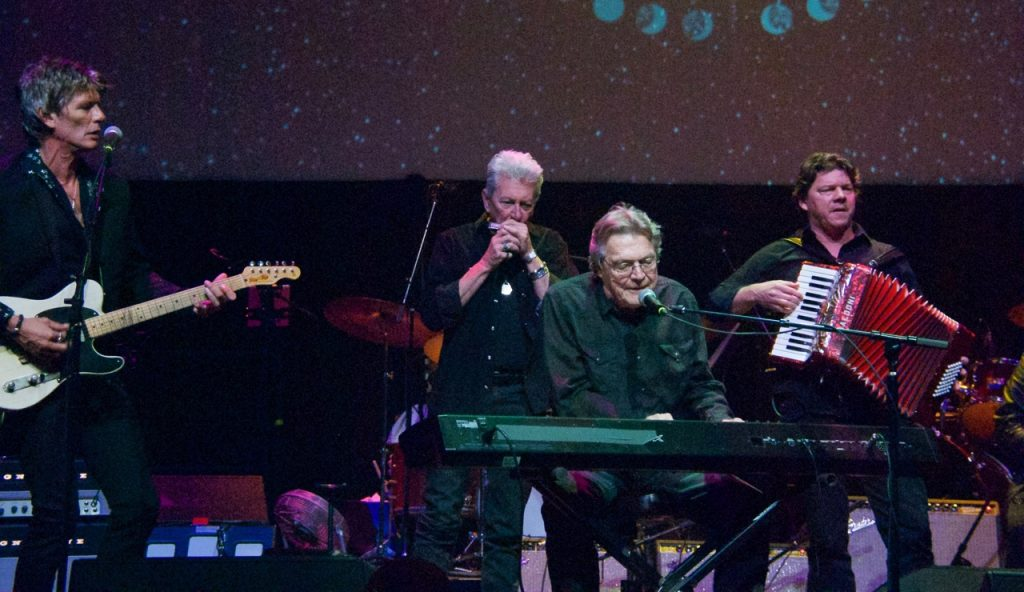 "Townes Van Zandt Award honoree Terry Allen taking Charlie Sexton, Joe Ely, and his son Bukka Allen along for a ride on the ""New Delhi Freight Train."" (Photo by Lynne Margolis)"