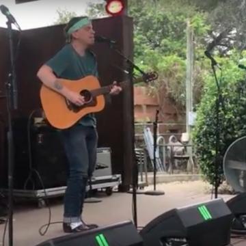 "Austin's Chris Fullerton singing his ""Epilepsy Blues"" at the LSM/KOKE-FM Dillo Mixer at Threadgill's."