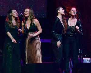 "Savannah Welch, Kelley Mickwee, Liz Foster and Jamie Wilson of the Trishas singing during the ""Femmes for SIMS"" portion of the evening. (Photo by Lynne Margolis)"