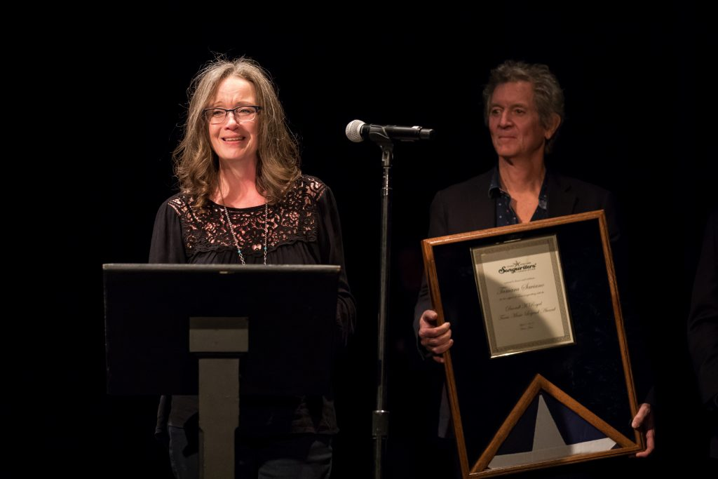 The Wisconsin Girl and the Houston Kid: Darrell K Royal Texas Music Legend Award honoree Tamara Saviano with one of her many Lone Star poet friends, Rodney Crowell. (Photo by Ted Parker Jr.)