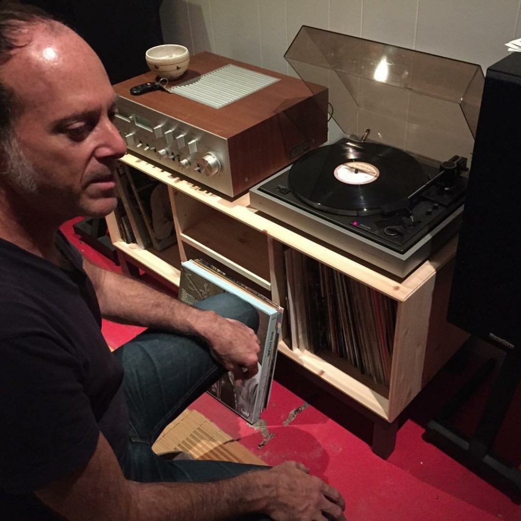 "Wax Poetic: George Reiff at his home in Austin on April 1, 2010, taking his vinyl copy of Ray Wylie Hubbard's ""The Ruffian's Misfortune"" for its maiden spin. It was the last album Reiff and Hubbard worked on together as co-producers (with Reiff playing all the bass) — though Reiff did go on to mix seven of the songs on Hubbard's next album, ""Tell the Devil I'm Getting There as Fast as I Can,"" due out later his year. (Photo by Richard Skanse)"