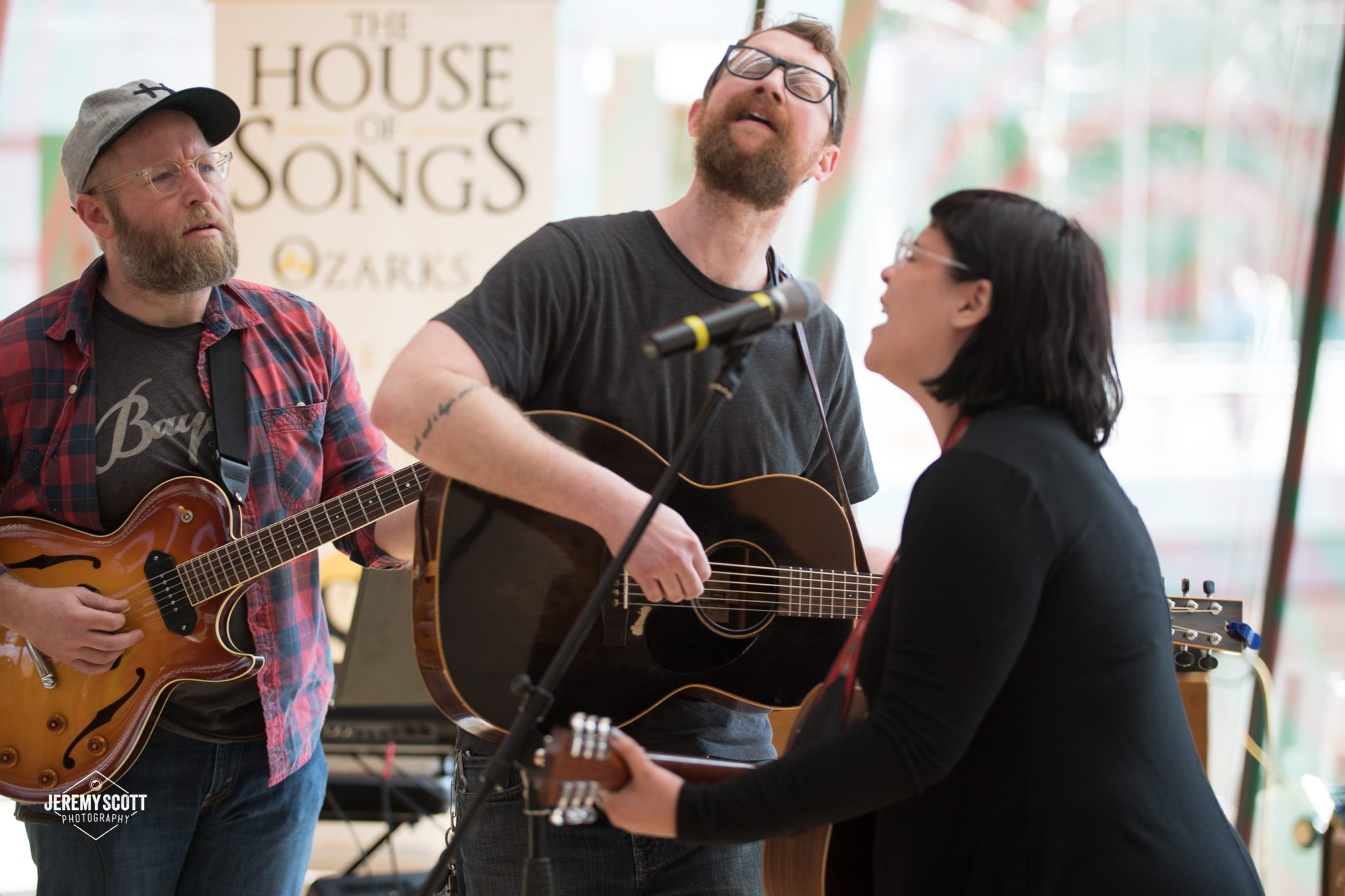 From left: Bryan Hembree and Ryan Pickop, both of Fayetteville, Arkansas, and Kalyn Fay of Tulsa, Oklahoma, work on a song together. (Photo by Jeremy Scott)