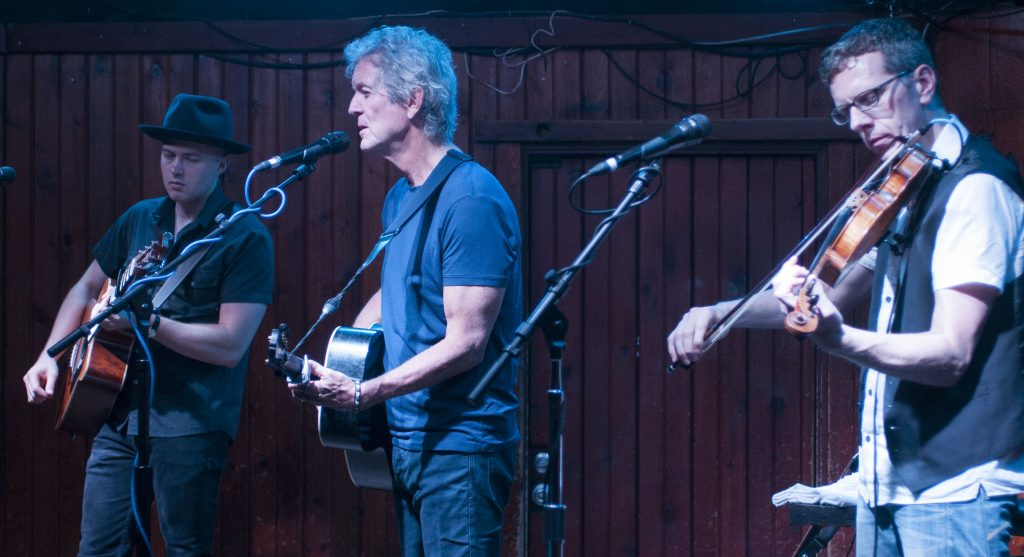 Rodney Crowell (center) at Austin's Saxon Pub with guitarist Joe Robinson and fiddle player Eamon McLoughlin. (Photo by Nichole Wagner)
