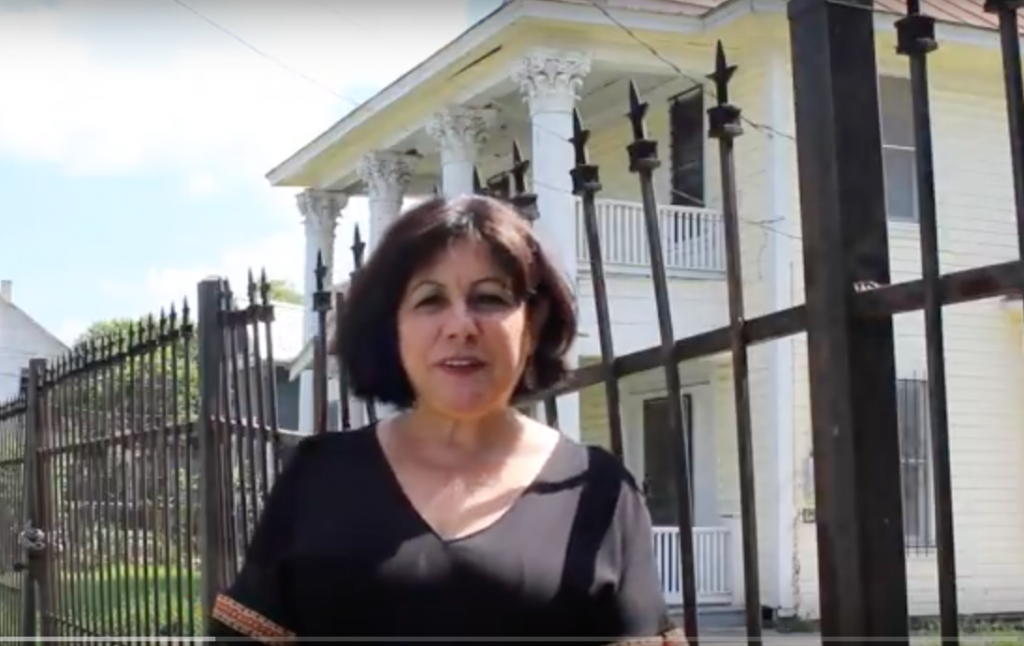 Tish Hinojosa outside of her childhood home in San Antonio. (Screenshot from her GoFundMe campaign video)