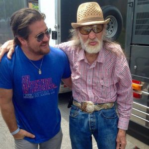 "Kyle Wieters, tour manager for the Randy Rogers Band, with Ben Dorcy, the world's oldest — some called him the ""first"" — roadie. (Photo courtesy Kyle Wieters)"