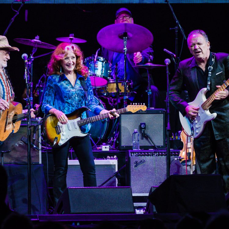 Willie Nelson, Bonnie Raitt, and Jimmie Vaughan rally for hurricane relief. (Photo by Charles Reagan Hackleman/Courtesy C3)