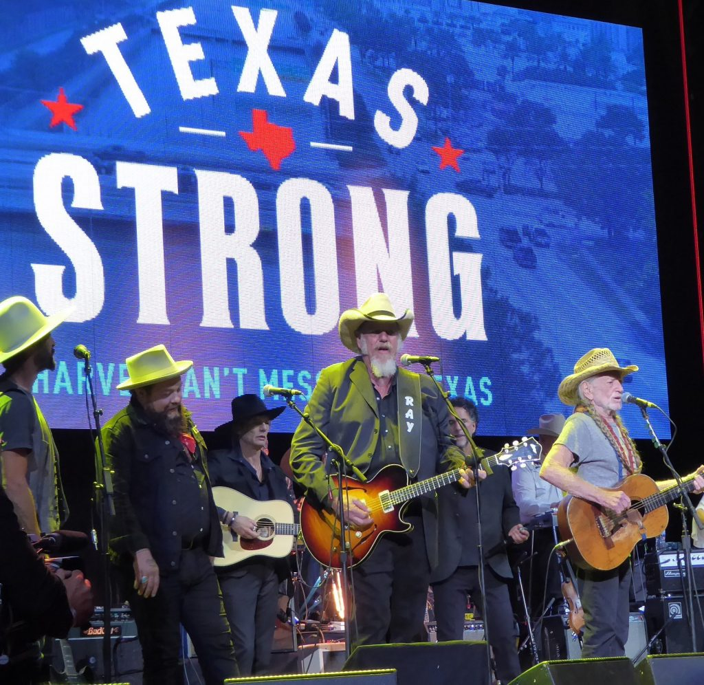 All together now: (from left) Ryan Bingham, Nathaniel Rateliff, Charlie Sexton, Ray Benson, Mickey Raphael, and Willie Nelson (Photo by Debbie L. Gray)