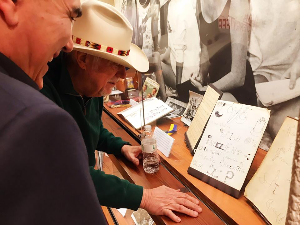 Jerry Jeff Walker shares a laugh with curator Hector Saldana while tripping through his back pages. (Photo by Mark Willenborg, courtesy the Wittliff Collections)