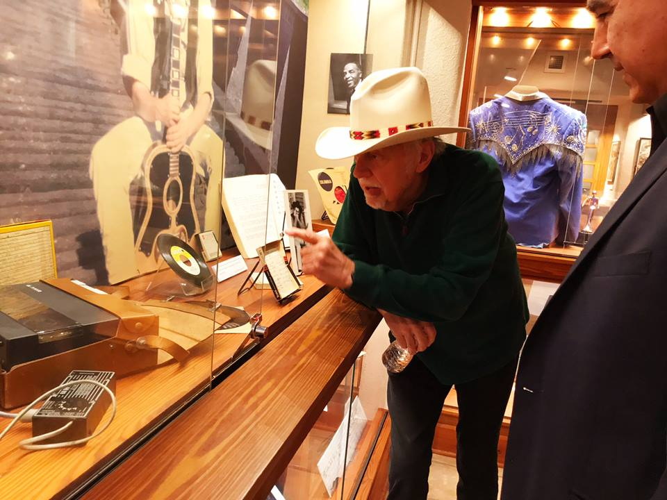 Jerry Jeff Walker during a visit to his exhibit at the Wittliff Collections, talking to Texas Music Curator Hector Saldana about his salad days singing folk songs in New Orleans. (Photo by Mark Willenborg, courtesy the Wittliff Collections)